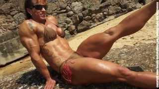 Gilberia Cunha showing her muscles on a beautiful Brazilian beach