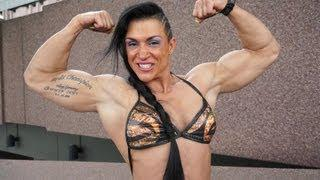 Suzy Kellner playing with her muscles - at FIBO Germany - part III