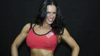 Olga Kickenber posing at FIBO - Germany